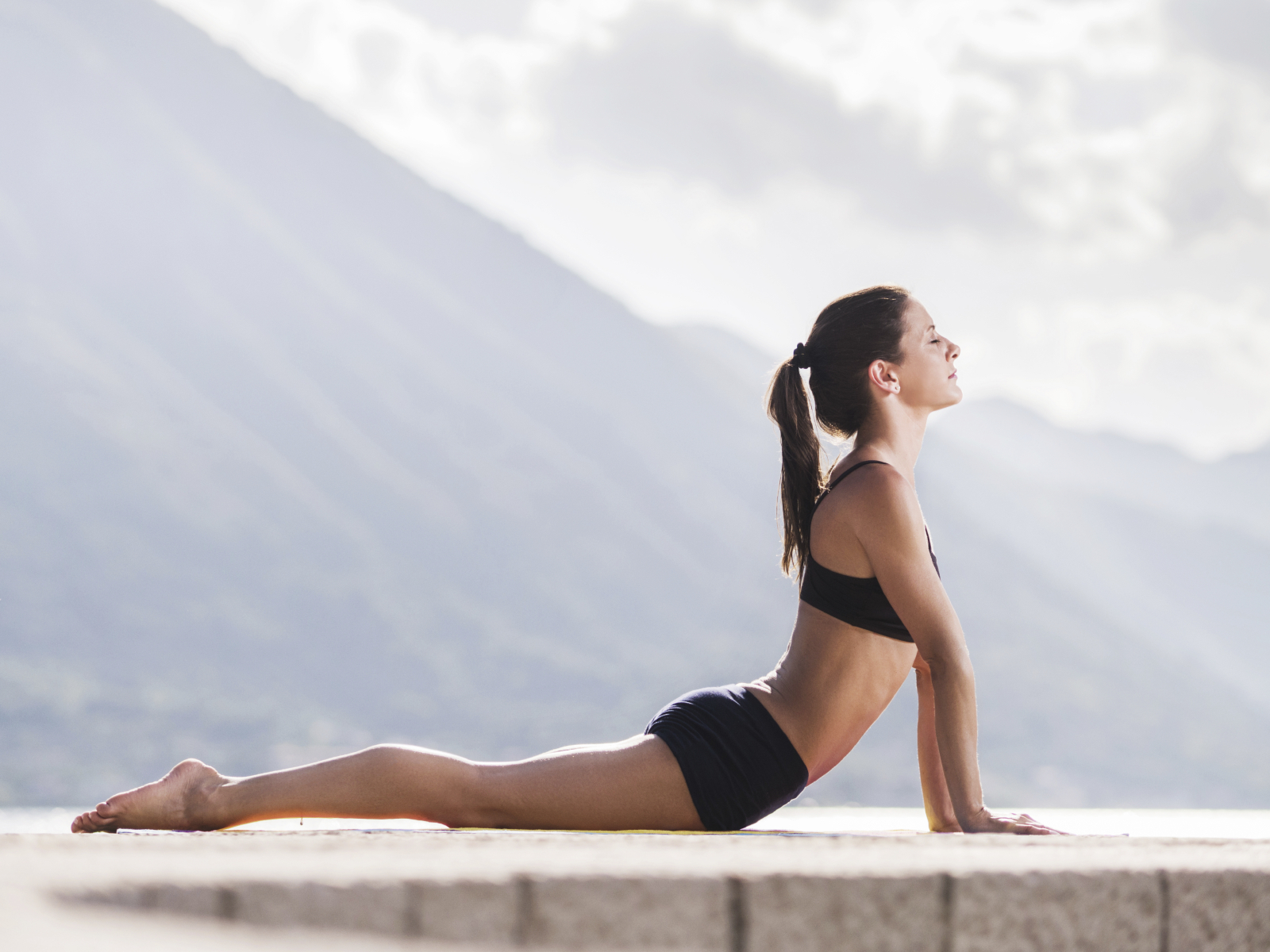 Side View Of A Young Woman In Cobra Pose