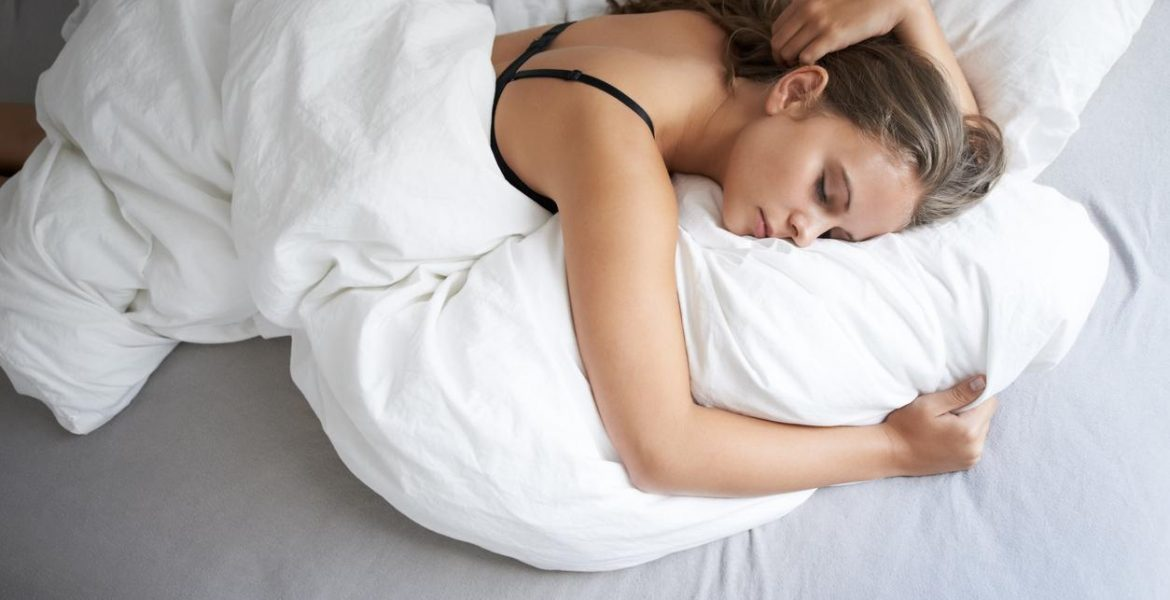 a woman trying to sleep in bed