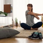 woman exercising at home