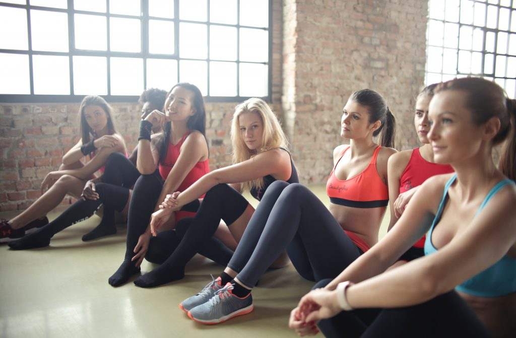 Women sitting on the floor of a workout class