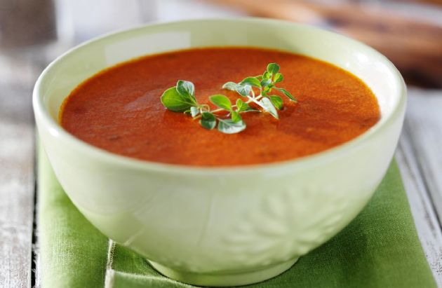 Tomato soup in white bowl.