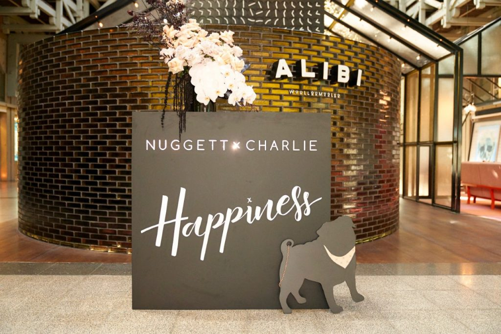 Sign reading Nugget x Charlie 'Happiness'
