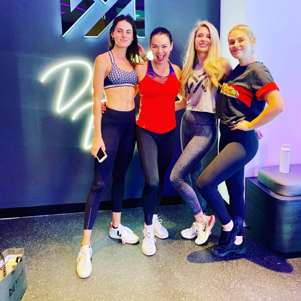 Four fit girls in bright fitness gear