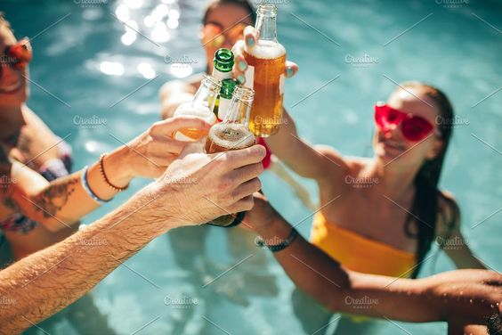 friends in a pool drinking alcohol