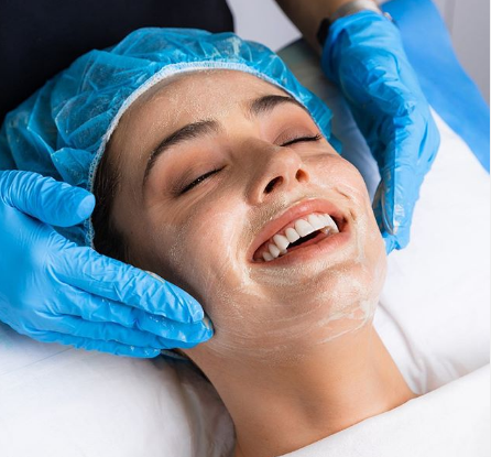 treatments for glowing skin-woman getting a facial