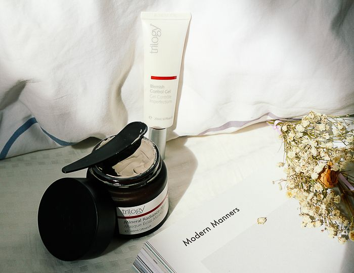 Triology Mineral Radiance Mask in flatlay on bed.