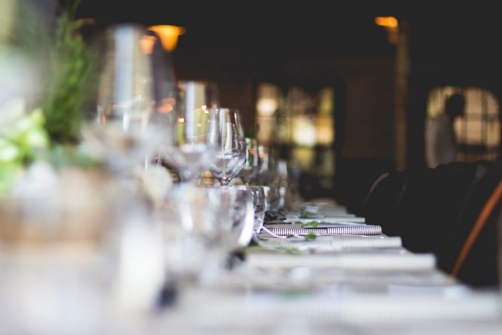 white tablecloth set with glasses in a restaurant