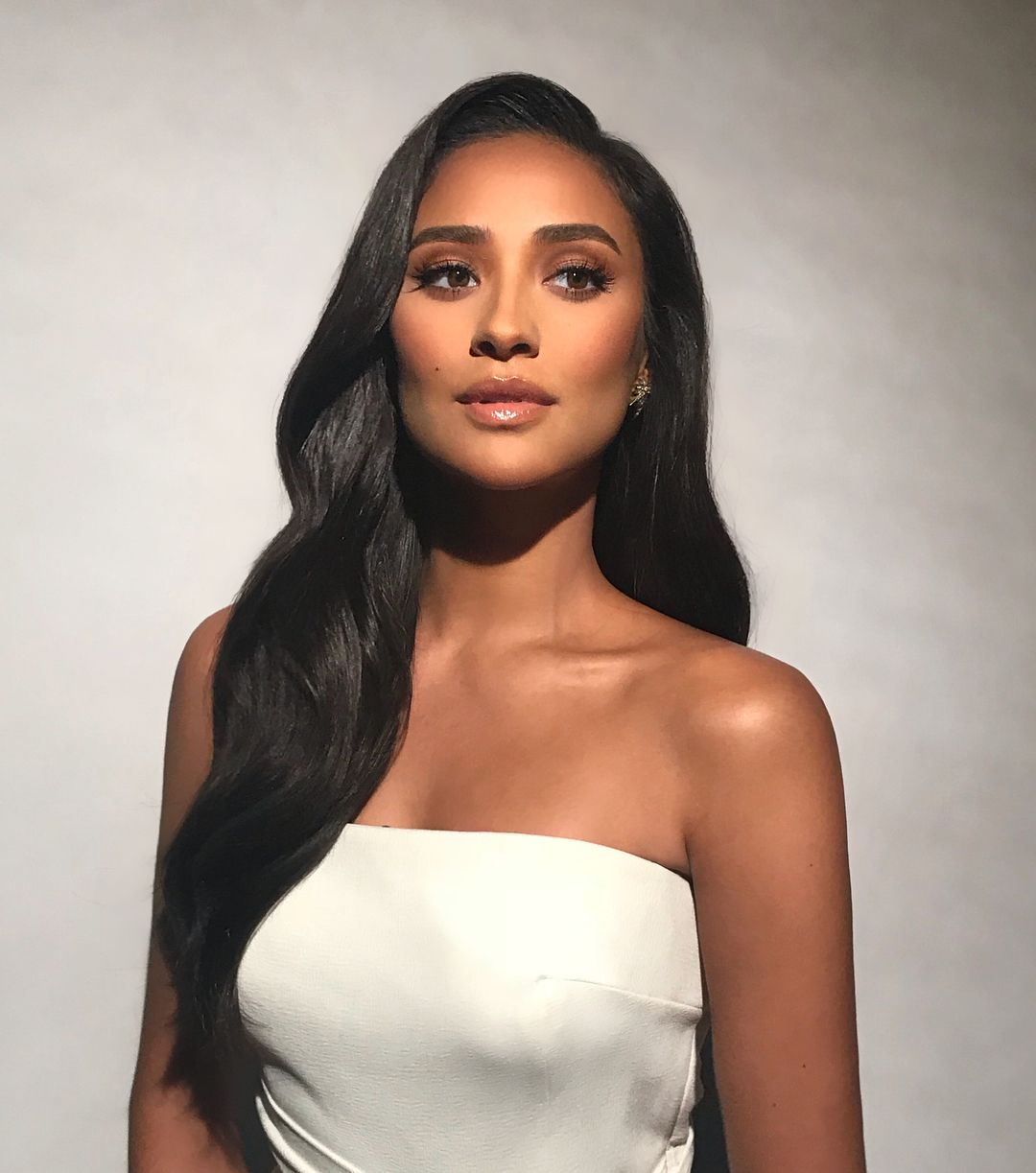 Shay Mitchell posing in makeup.