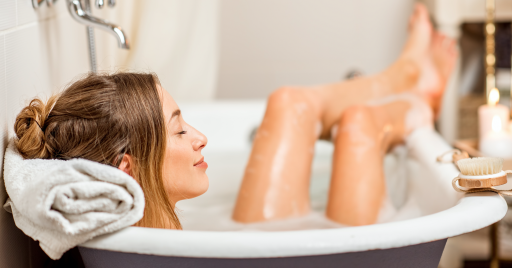 a women relaxing in a bath whilst in self-isolation