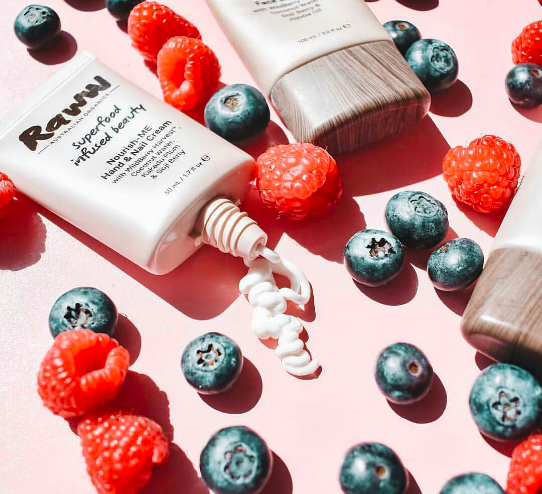 Raww Nourish-ME Hand & Nail Cream flatlay with raspberries and blueberries image from pinterest