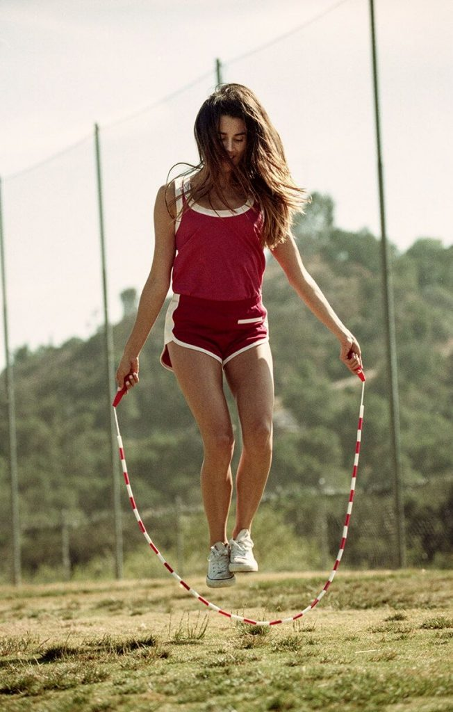 Girl skipping with vintage skipping rope
