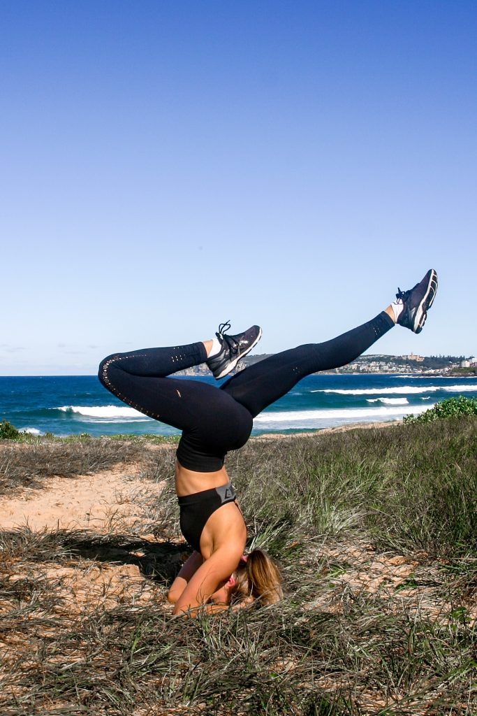 girl doing a headstand