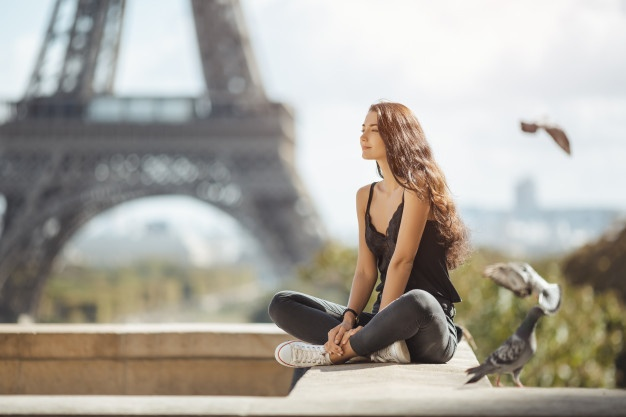 Woman in Paris: Dream big, but plan for the future. The landmarks and trips will still be there in the future.