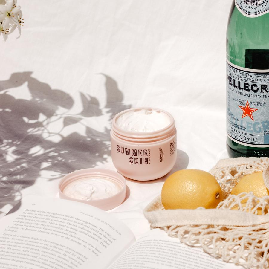 summer skin body moisturises surrounded by summer items