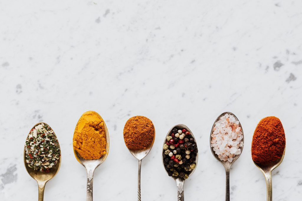 spices on spoons for seasoning food