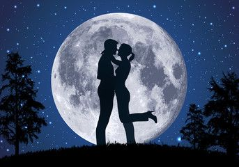 couple in front of the moon
