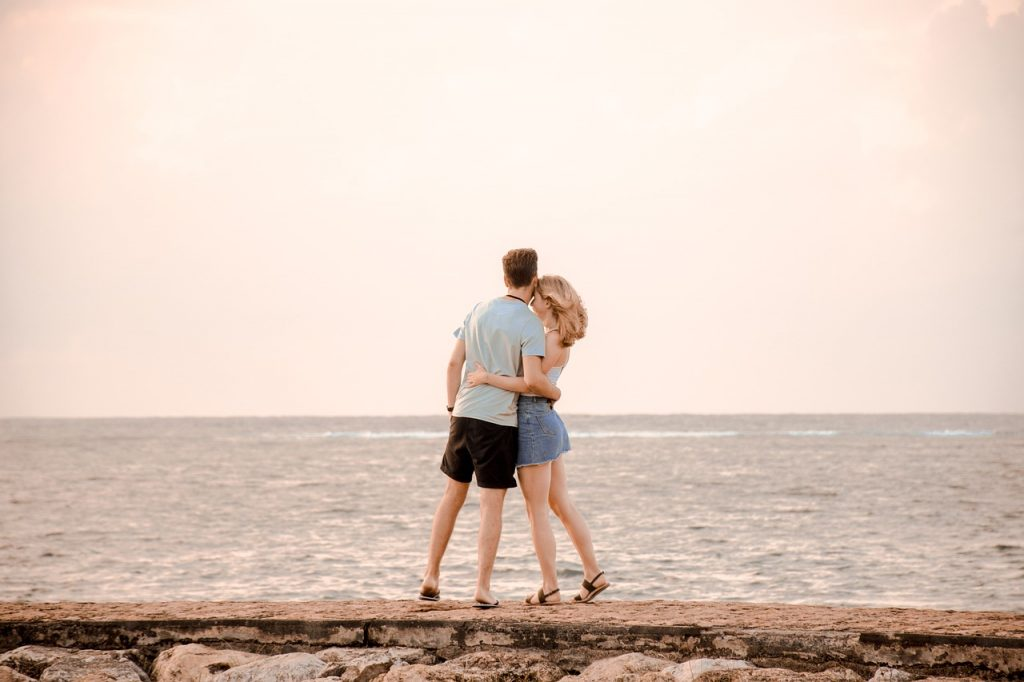 couple in front of the ocean