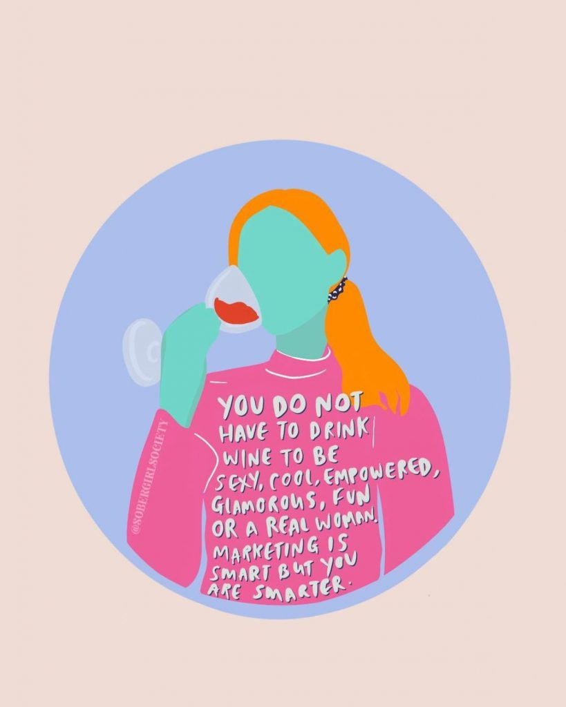 Instagram post by The Sober Girl Society. Graphic designed woman with cyan skin, orange hair and a pink turtle neck drinking red wine. Quote on sweater. You do not have to drink wine to be sexy, cool, empowered, glamorous, fun or a real woman. Marketing is smart but you are smarter.