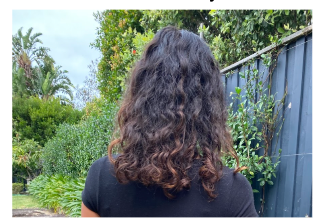 My hair just past shoulder length returned to it's natural brown colour and some curls evident.