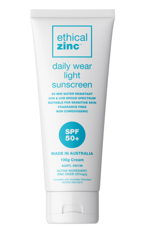 White bottle with blue label containing sunscreen