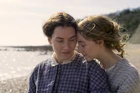 Two women embracing on the beach