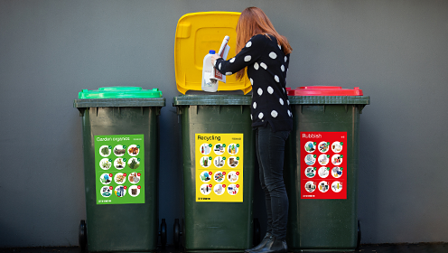 Colour coded and clearly labelled recycling and general waste bins in Sydney.